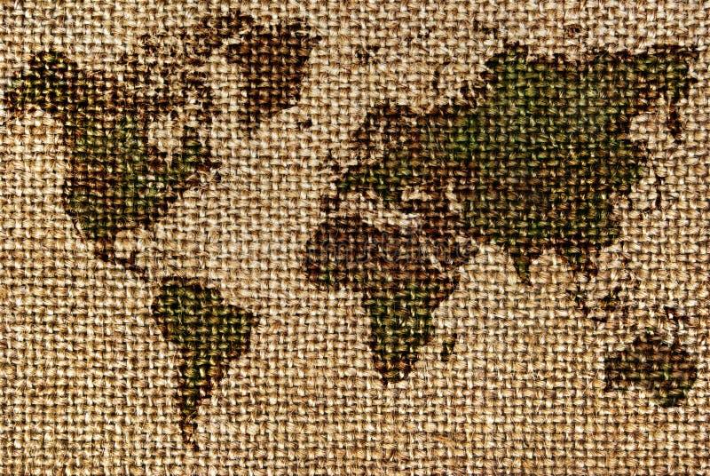 Światowa mapa rysująca na szorstkich, starych tkaninach, zdjęcie stock