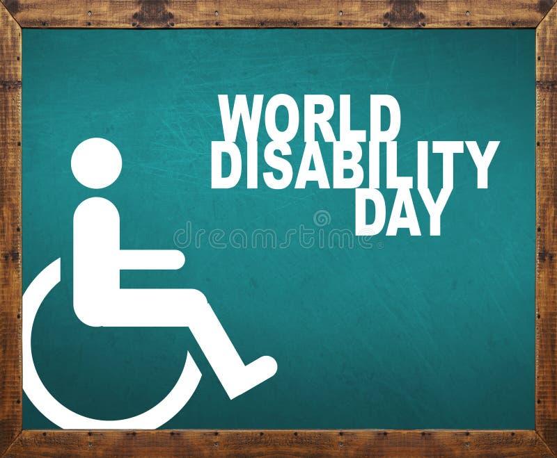 Światowy inwalidzki dzień pisać na błękitnym blackboard obrazy stock