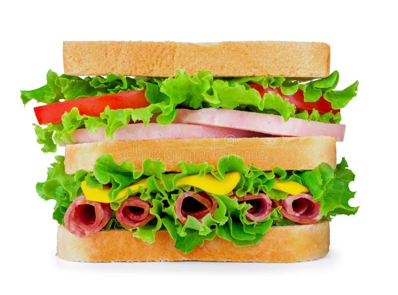 Świeża kanapka z salami, ser, pomidor, sałata na białym iso obraz stock