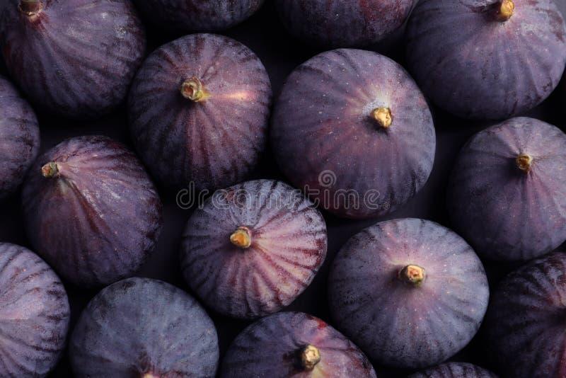 Świeże dojrzałe figi jako tło, odgórny widok zdjęcie royalty free