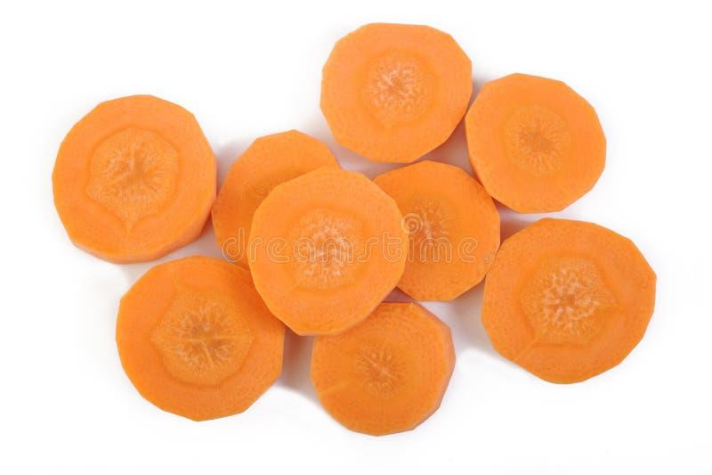 Świeże pokrojone marchewki na bielu obraz stock