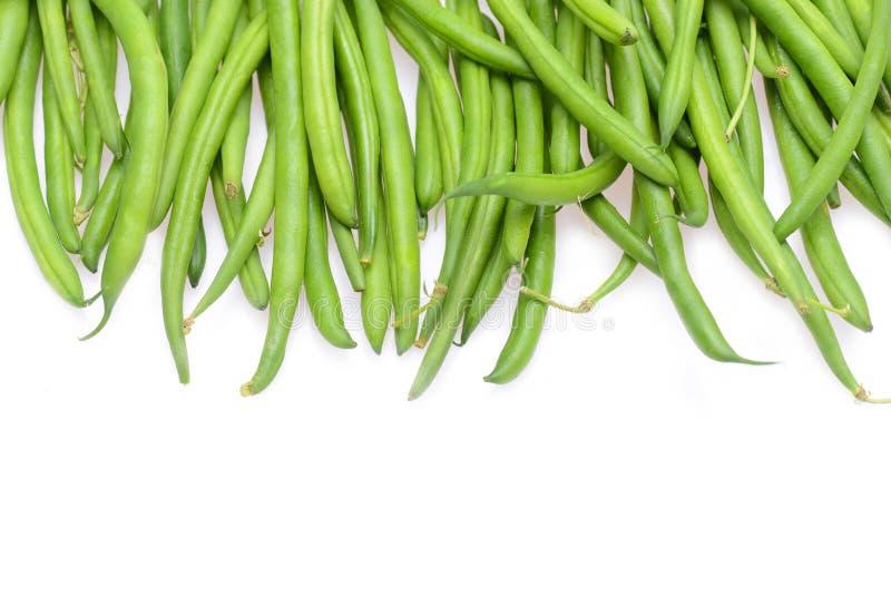Świeże zielone smyczkowe fasole odizolowywać na białym tle zdjęcie royalty free