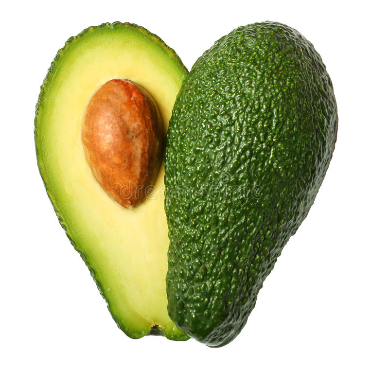 Świeży avocado w formie serca odizolowywającego na bielu obrazy stock