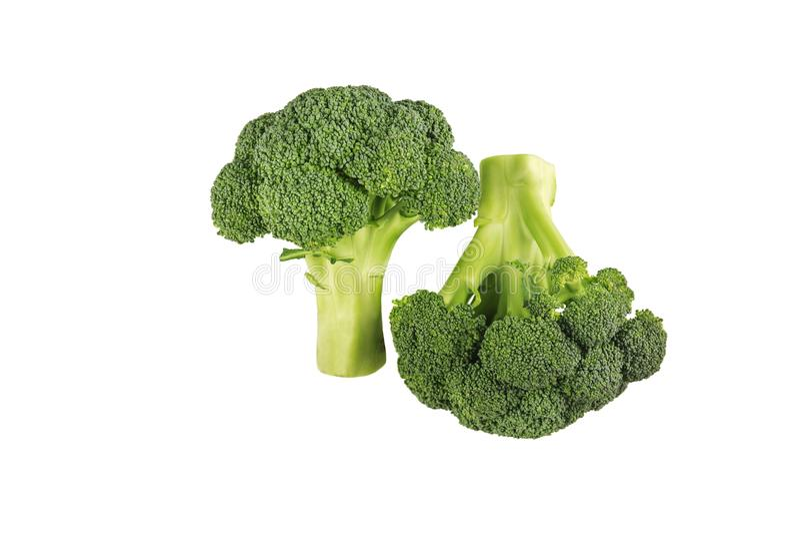 Świeży dwa zielonego brokułu odizolowywającego na białym tle obrazy royalty free