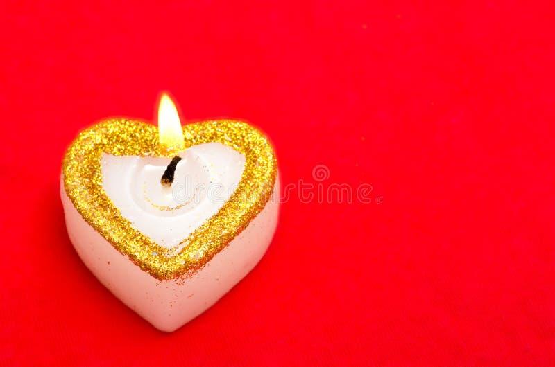 Świeczka Jako Serce Z Bezpłatną Przestrzenią Zdjęcie Stock