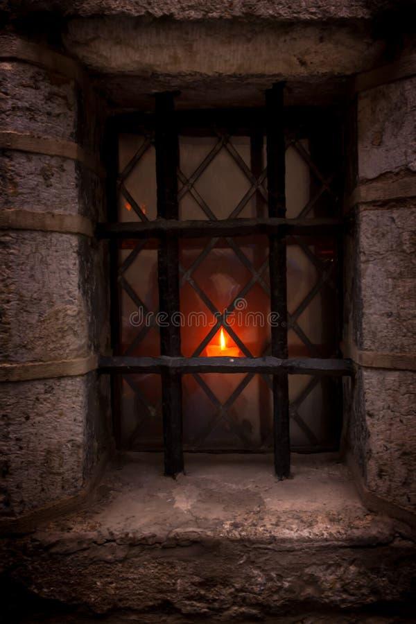 Świeczka Na Starym okno zdjęcie stock