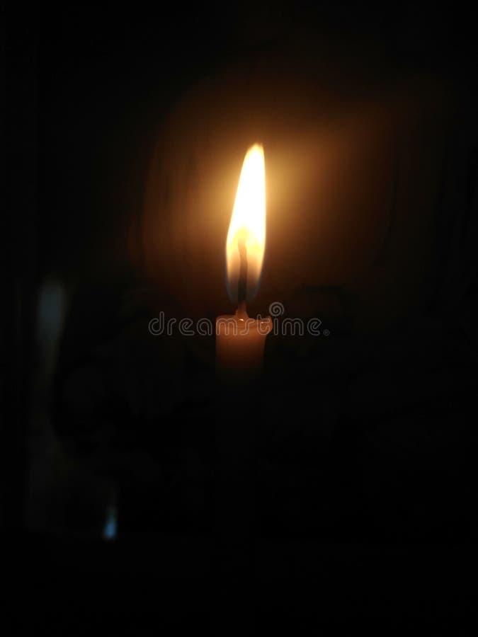 Świeczka przed Buddha statuą obraz royalty free