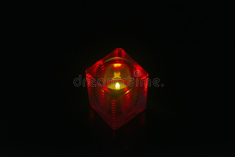 Świeczka w czerwonym właścicielu obrazy royalty free