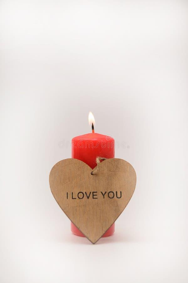 Świeczka z sercem na białym tle zdjęcia royalty free