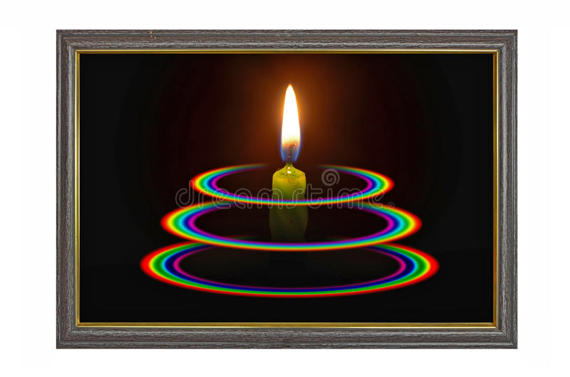 Świeczki światło z trzy okrąg tęczami w błękit ramie obrazy stock