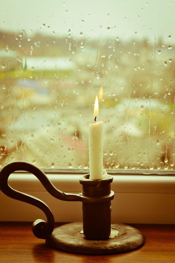 świeczki dzień zaświecający dżdżysty obrazy royalty free