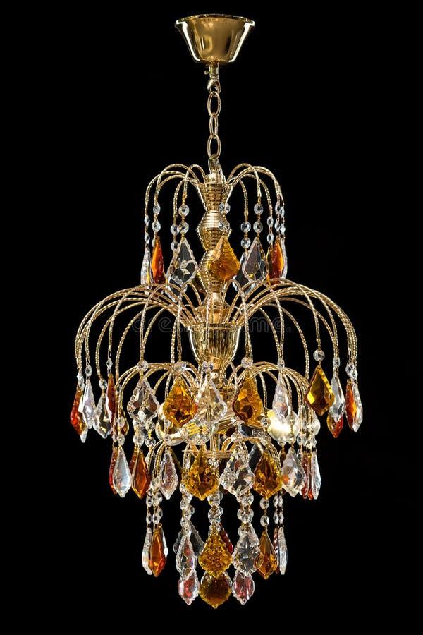 Świecznik dla wnętrza żywy pokój świecznik dekorował z kryształami i bursztynem odizolowywającymi na czarnym tle fotografia stock
