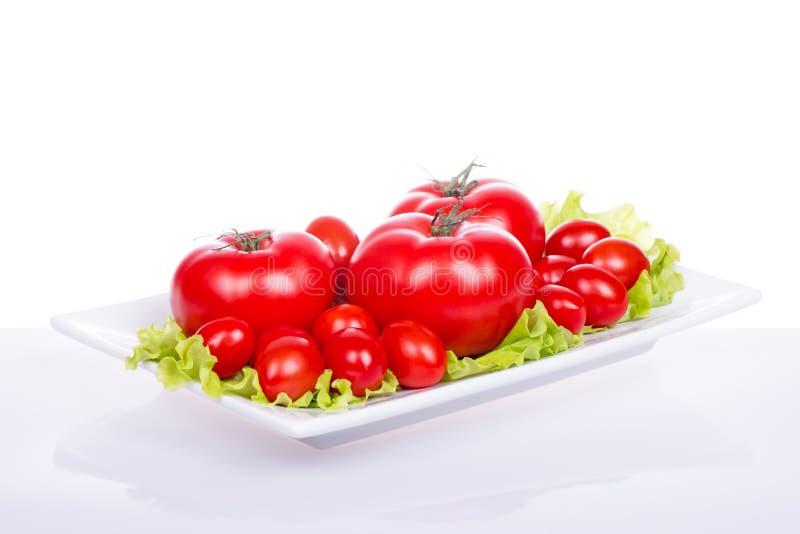 Świezi czereśniowi pomidory i sałatka obrazy royalty free