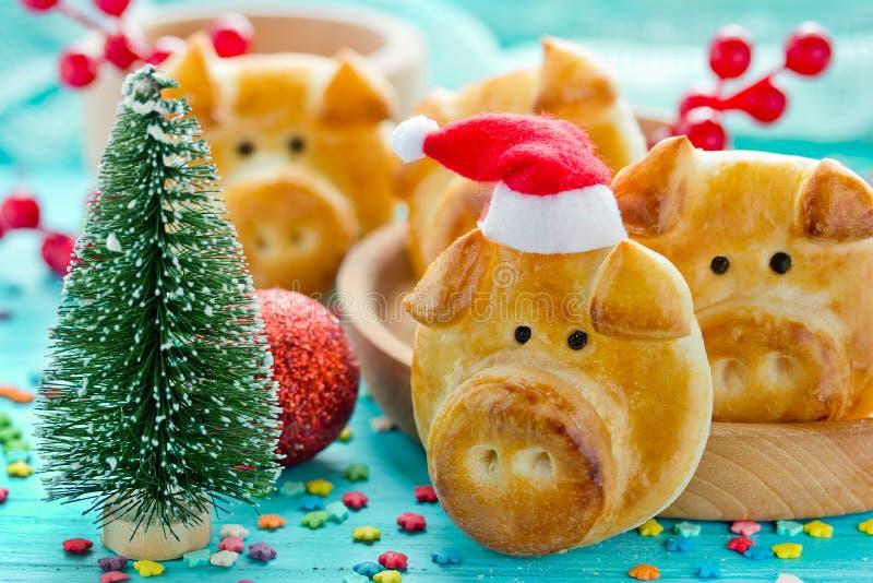 Świniowate babeczki, prosiątko obiadowe rolki, urocze jadalne świnie od ciasta zdjęcie stock