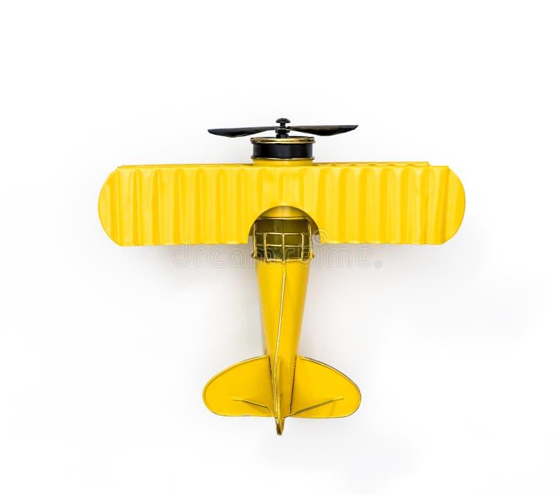 Żółtego metalu zabawki samolot odizolowywający obraz stock