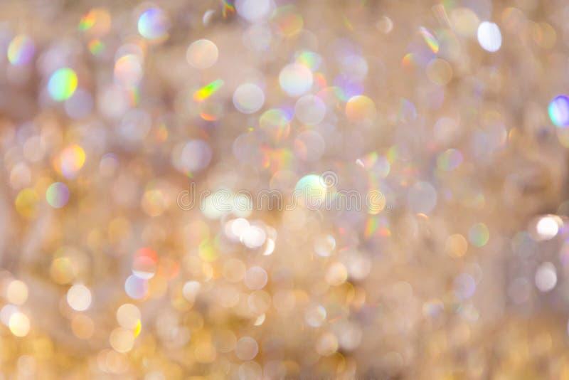 Żółtego złota i kolor perły błyskotania bokeh zaświeca tło fotografia royalty free