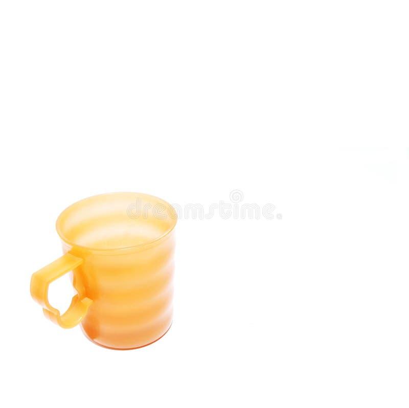 Download Żółty kubek obraz stock. Obraz złożonej z napój, yellow - 138965