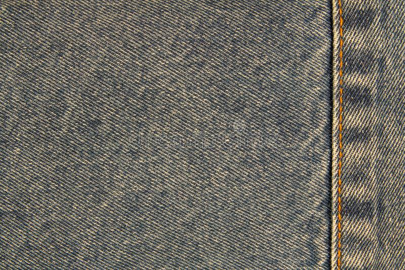 Żółty szew na drelichowej cajg teksturze dla tła lub przestrzeni dla teksta lub wizerunku obraz royalty free