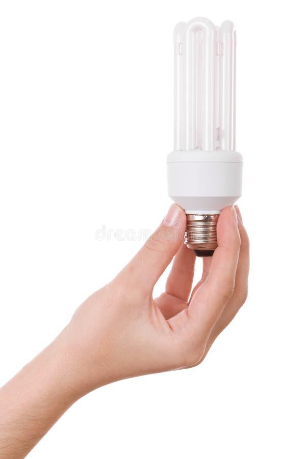 żarówki ścisły fluorescencyjny ręki mienia światło obrazy stock