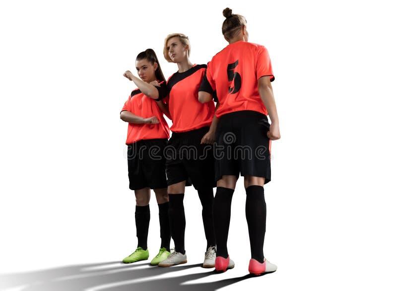 Żeńscy gracze piłki nożnej w ścianie odizolowywającej na bielu zdjęcie stock