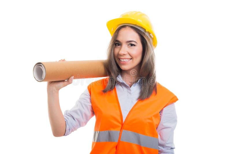 Żeńscy konstruktora lub architekta mienie staczający się projekty obraz stock