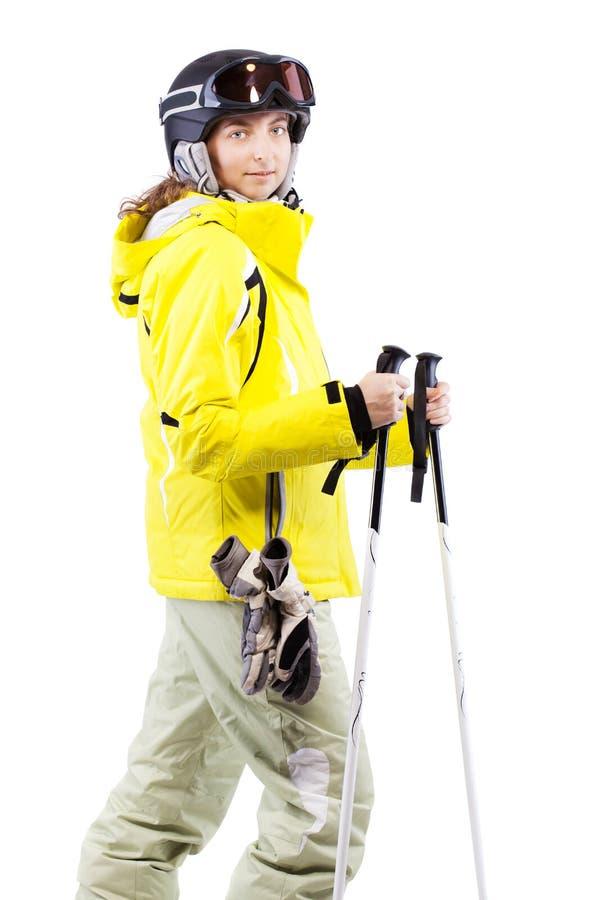 Żeńska narciarka w żółtej kurtce fotografia stock