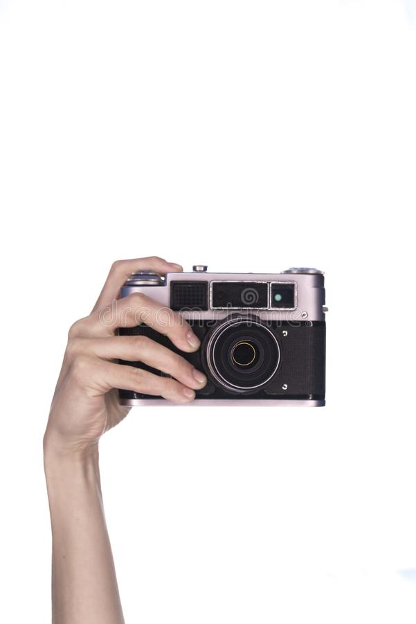 Żeńska ręka chwyta rocznika kamera zdjęcia royalty free
