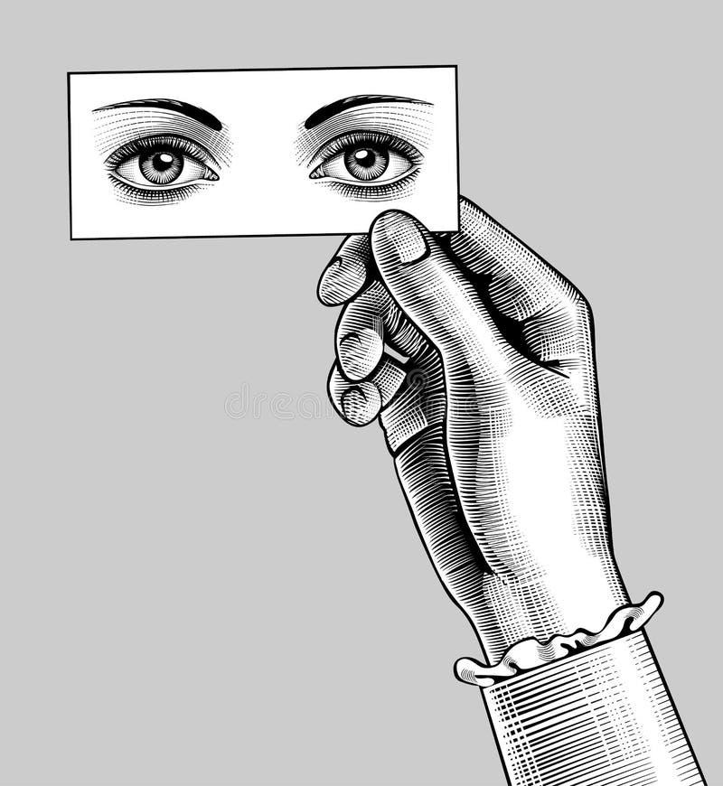Żeńska ręka trzyma kartę z oczu rysować royalty ilustracja
