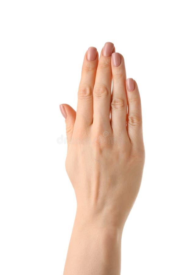 Żeńska ręka z nagim manicure'em na białym tle obraz royalty free