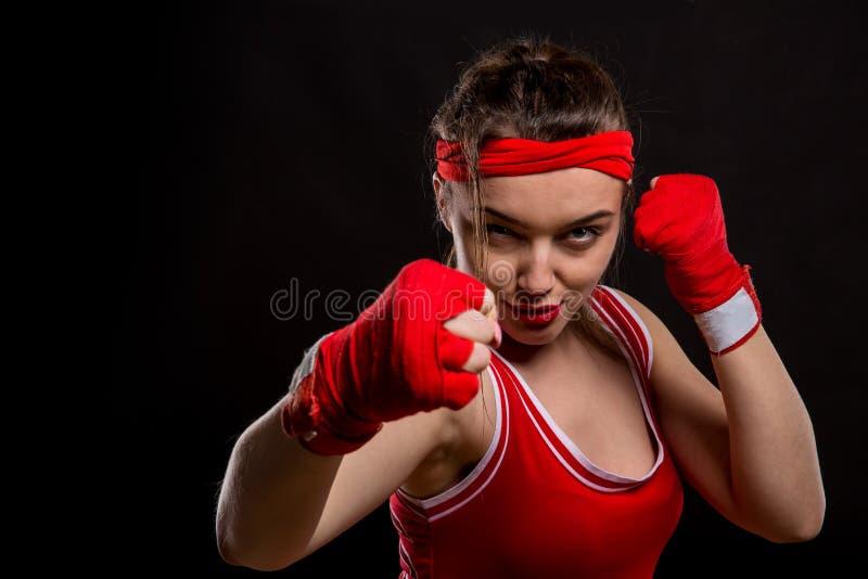 Żeński bokser w czerwonych rękawiczkach i sportswear obrazy royalty free