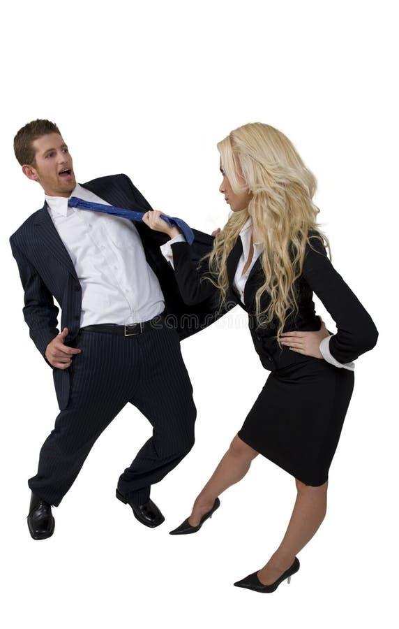 żeński mężczyzna ciągnięcia krawat zdjęcie royalty free