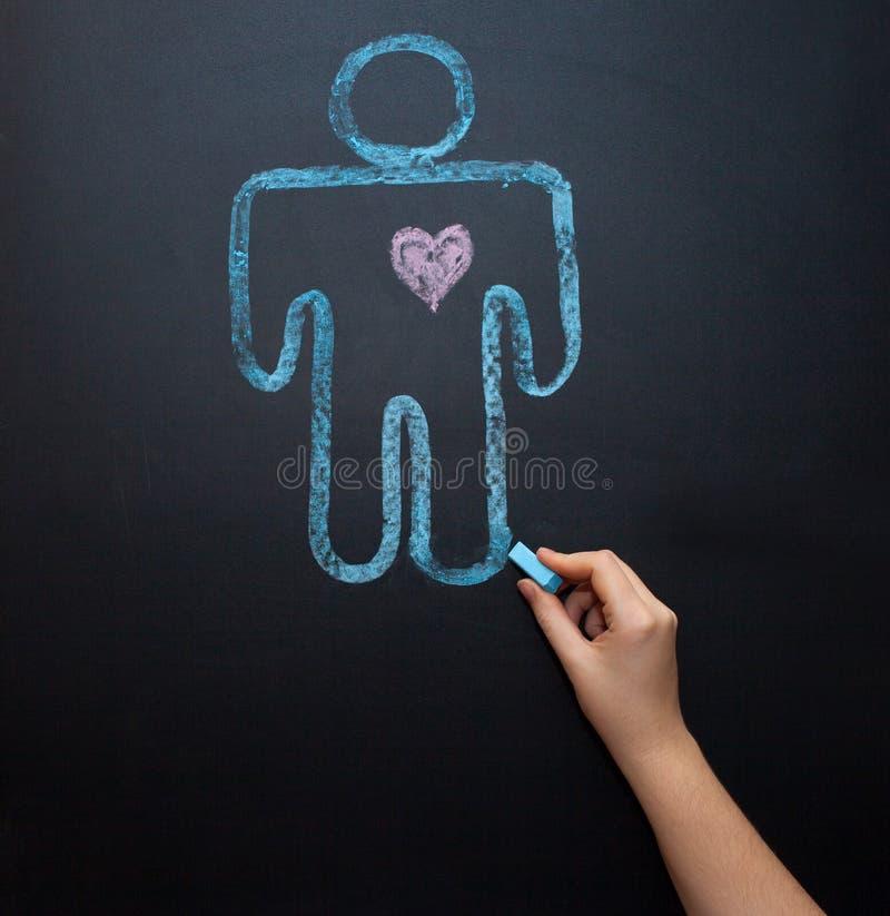 Żeński rodzaju symbol jest równy męski pojęcie równouprawnienie płci Rysować z kredą na kredowej desce zdjęcie royalty free