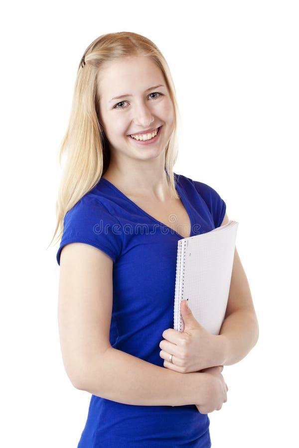żeński szczęśliwy ochraniacz uśmiecha się studenckiego writing zdjęcia royalty free