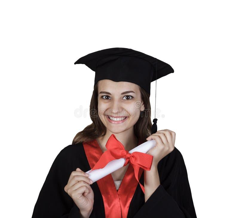 Żeński uczeń w skalowanie togi mieniu rezerwuje i dyplom odizolowywający na białym tle zdjęcia stock