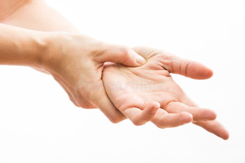 Żeńskie ręki robią acupressure na ręce, obrazy stock
