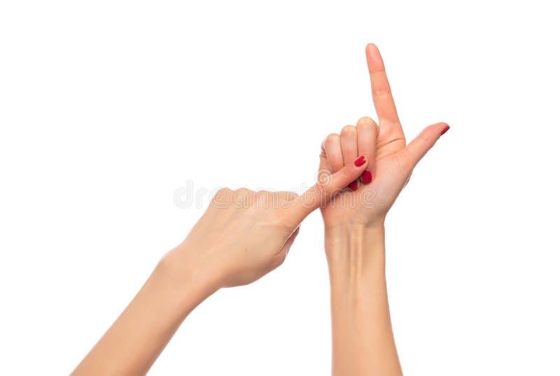 Żeńskie ręki zginają palce na białym tle obrazy stock
