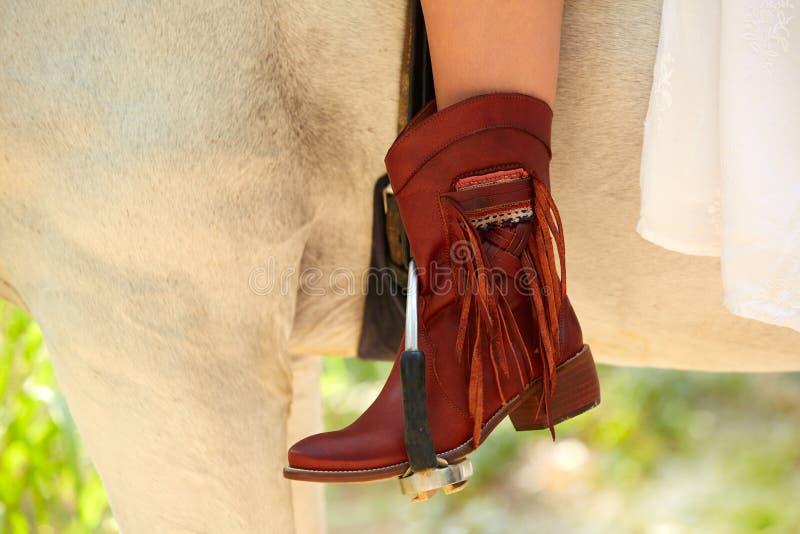 Żeńskiego konia jeźdza rzemienny przypadkowy but obrazy royalty free