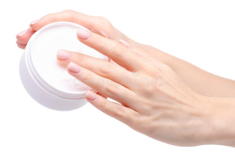 Żeńskiego ręka białego słoju opieki kremowy piękno zdjęcia stock