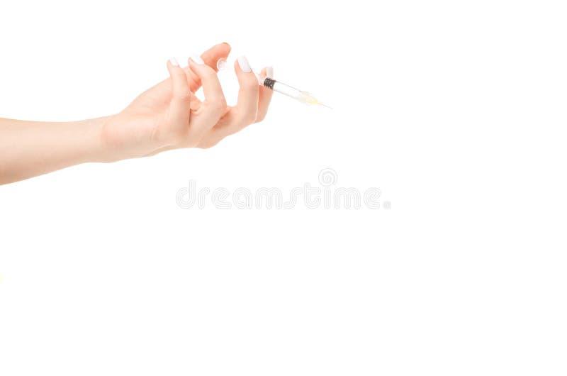 Żeńskiej ręki strzykawki kosmetologii medycyny hyalurowy kwas fotografia royalty free