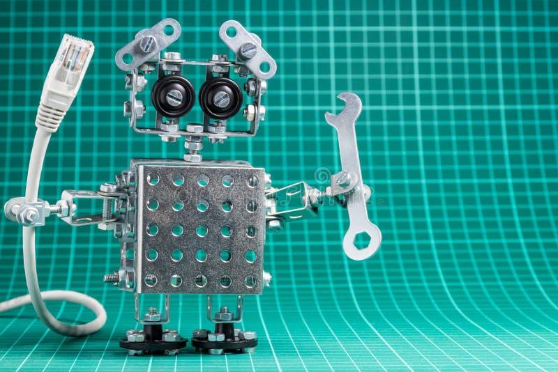 Żelazny robot trzyma rj45 kabel i wyrwanie fotografia royalty free