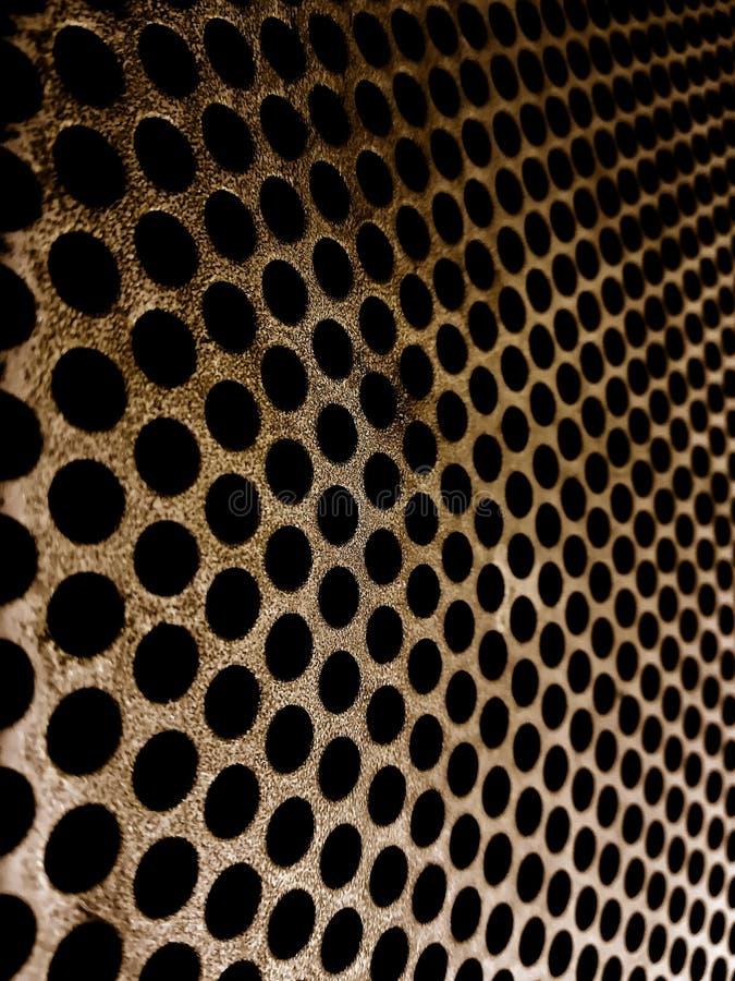 Żelazny talerz z miarową małą dziury teksturą fotografia stock