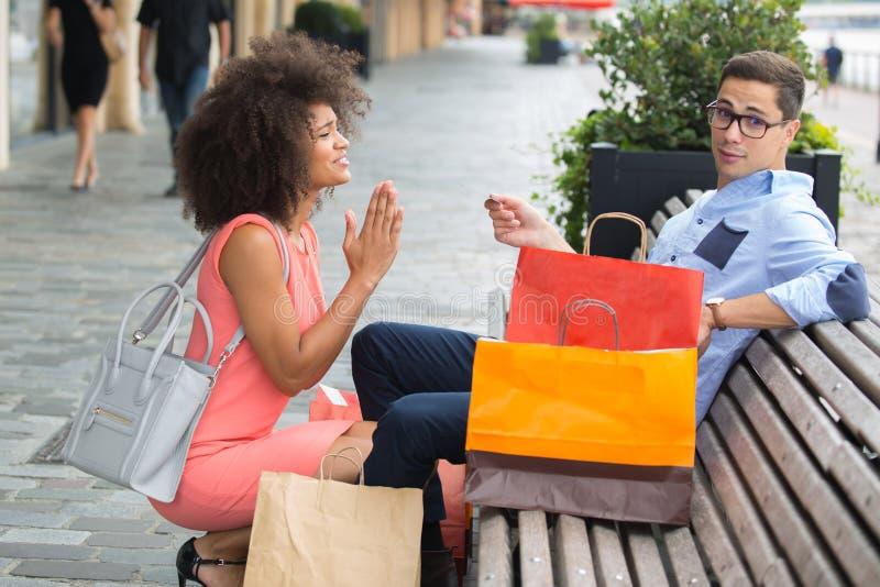 Żony modlenia mąż utrzymywać zakupy obrazy stock