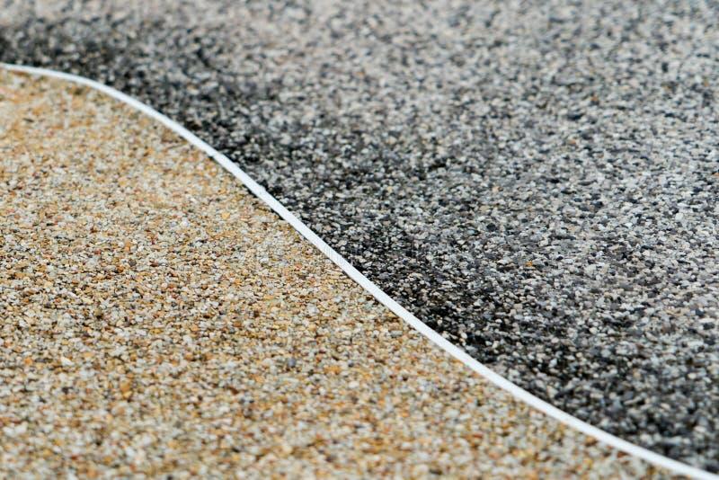 Żwir tekstury nawierzchniowy tło, dwa różnic kolor, zmrok i złoto, Yang pojęcie obrazy stock