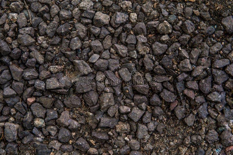 Żwir tekstury odgórny widok Drogowy czarny żwir obrazy stock