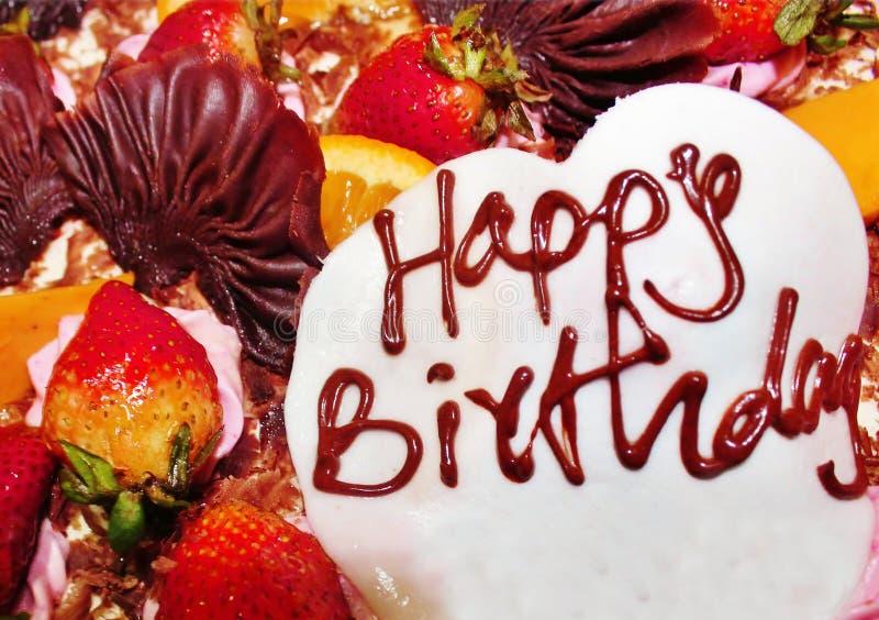 Życzenia urodzinowe w ciastkach i owocach zdjęcia stock