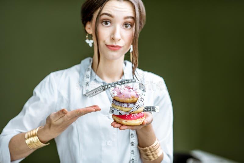 Żywiony z niezdrowymi donuts fotografia stock