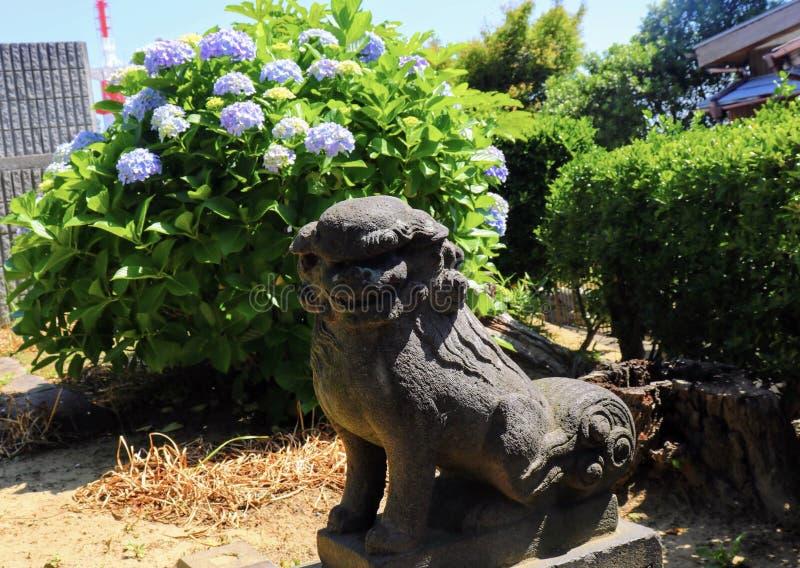 Άγαλμα σκυλιών στο πάρκο Wakamatsu στοκ εικόνα