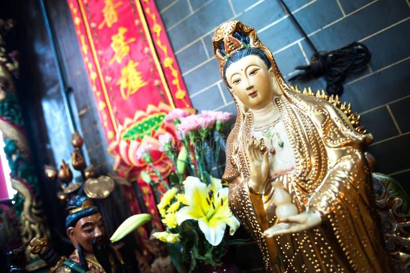 Άγαλμα Guanyin, η θεά του ελέους, σε έναν ναό Χονγκ Κονγκ στοκ εικόνες με δικαίωμα ελεύθερης χρήσης