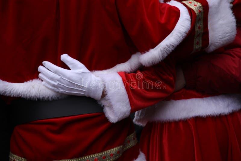 Άγιος Βασίλης και γυναίκα Χριστουγέννων, Χαρούμενα Χριστούγεννα στοκ εικόνα