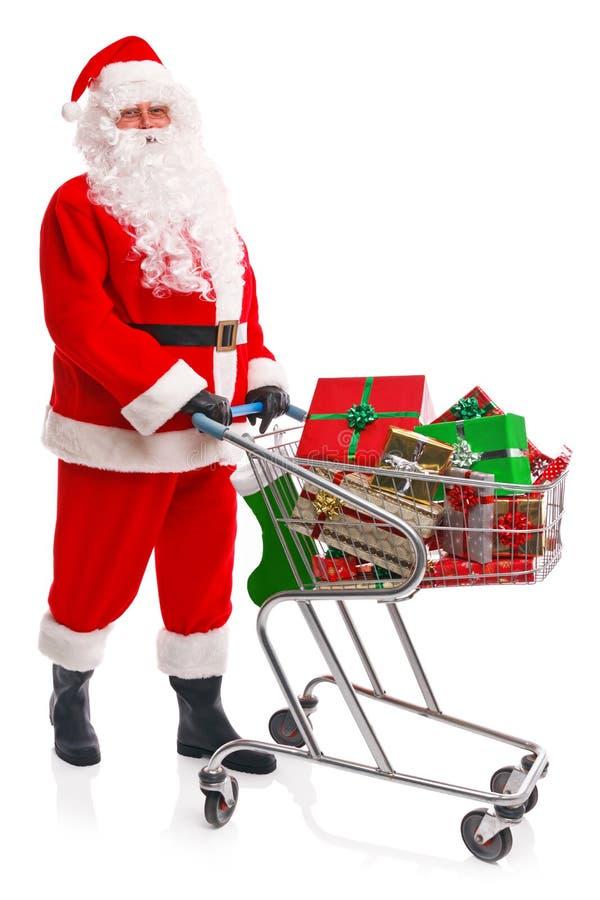 Άγιος Βασίλης που κάνει τις αγορές Χριστουγέννων του στοκ εικόνα